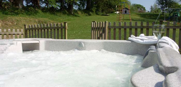 Relax in a private hot tub at North Hayne Farm