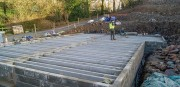 Block and beam floor being built
